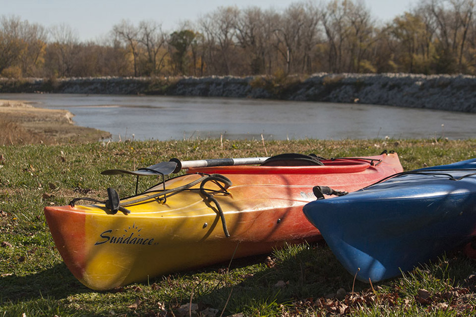 Kayaks rest on shore before we paddle them down the Elkhorn River.