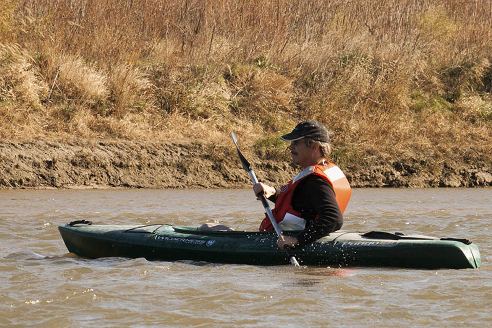 Allen paddles the Elkhorn.