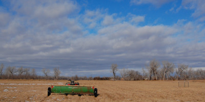 Spreading seed on a winter day. (Ariana Brocious)