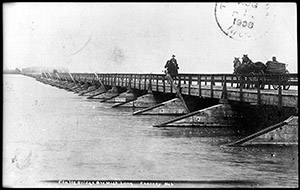 An early bridge spanning the mile-wide girth of the Platte River. (Nebraska State Historical Society)