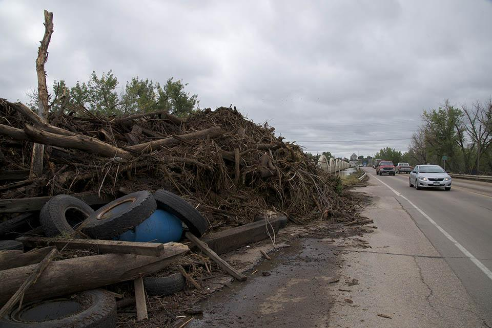 Debris from the South Platte River piled onto the side of the road near Fort Morgan, Colo., on September 16th, 2013. (Dave Showalter)