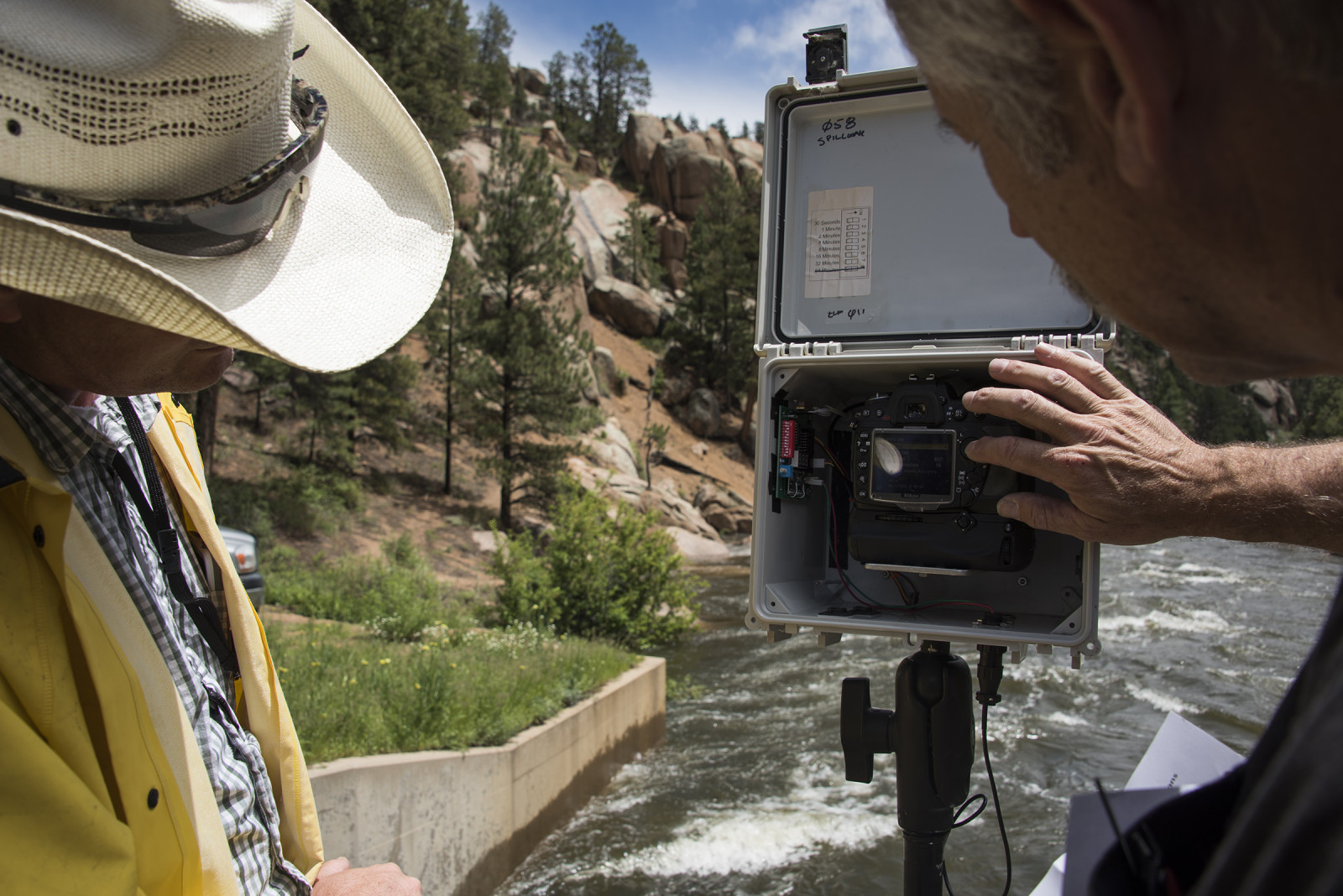 PBT camera technition, Jeff Dale shows a Denver Water employee how the timelapse cameras work. (Mariah Lundgren)