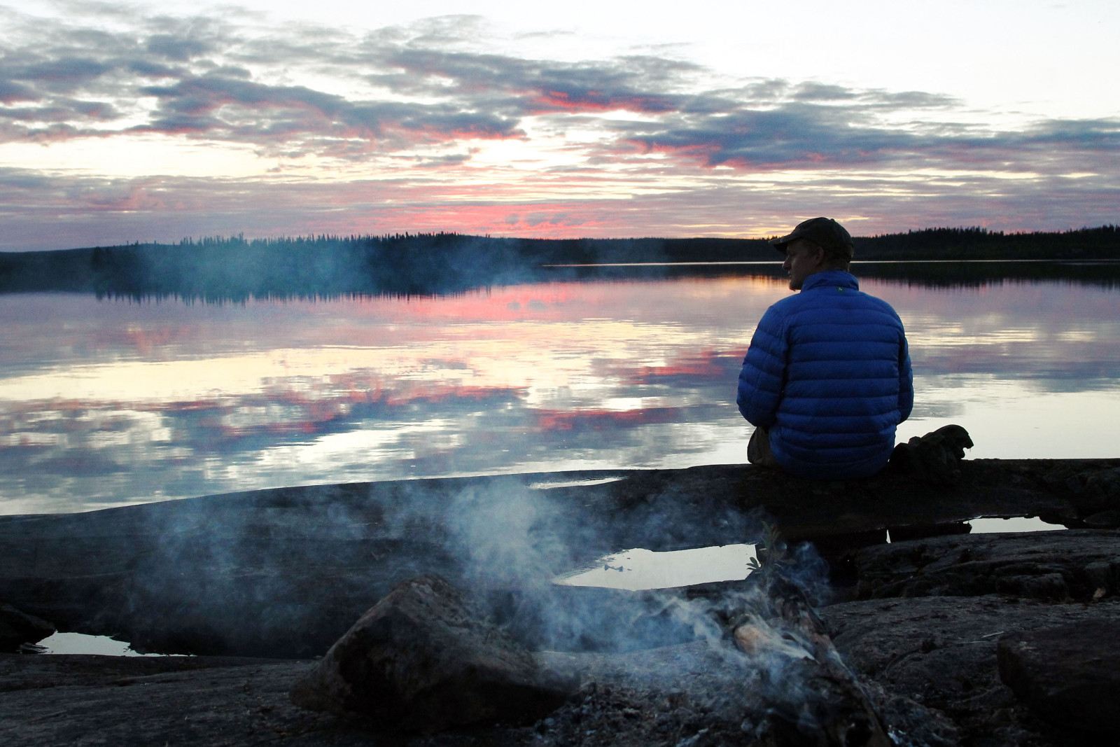 Watching an unusually colorful sunset in northern Saskatchewan after a full day of canoeing. (Cristina Woodworth)