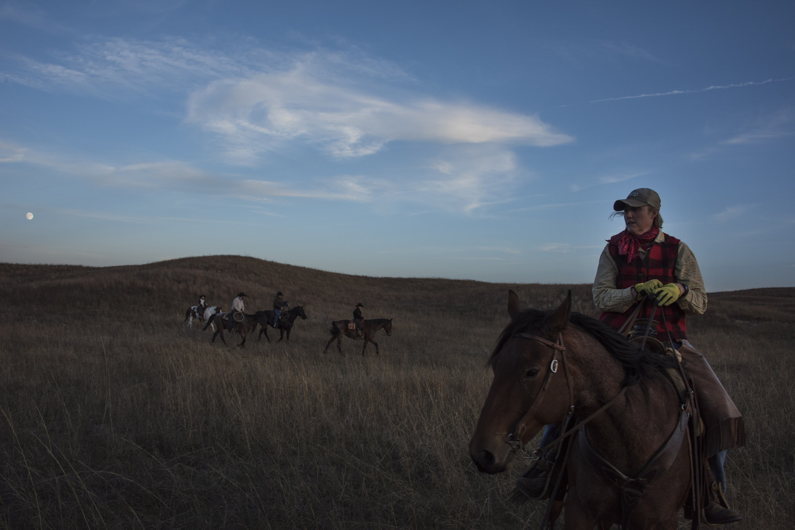 Guided by moonlight, Sarah and her family head back to their homes after a long day moving cattle. (Mariah Lundgren)