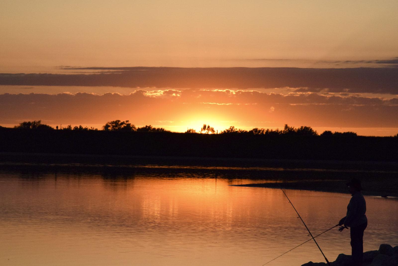 Sunsets on fisherwoman at Holmes Lake (Grace Bullington)
