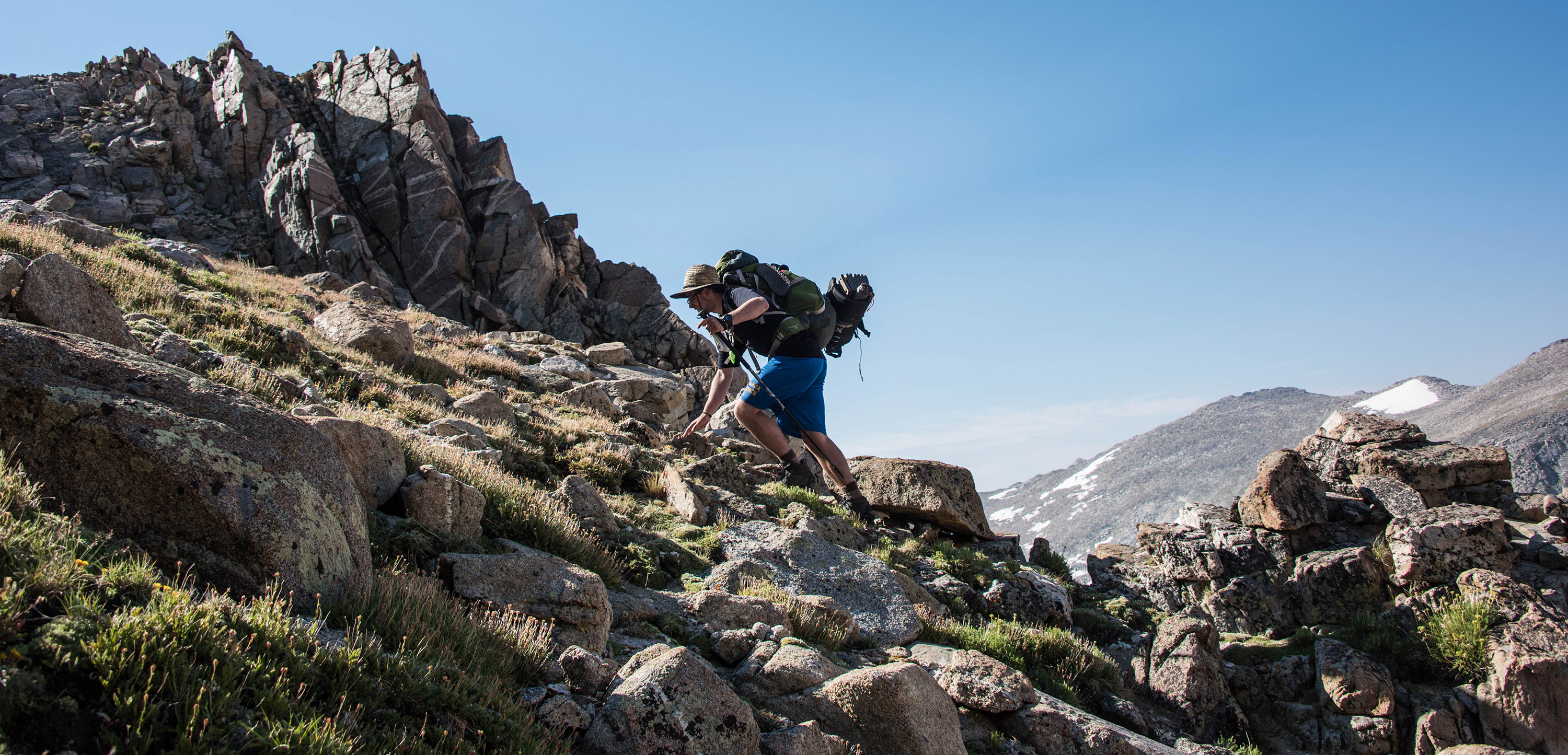Issac Ward hikes up a steep incline on day five in the backcountry. (Mariah Lundgren)